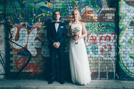 urban chic wedding couple brick wall