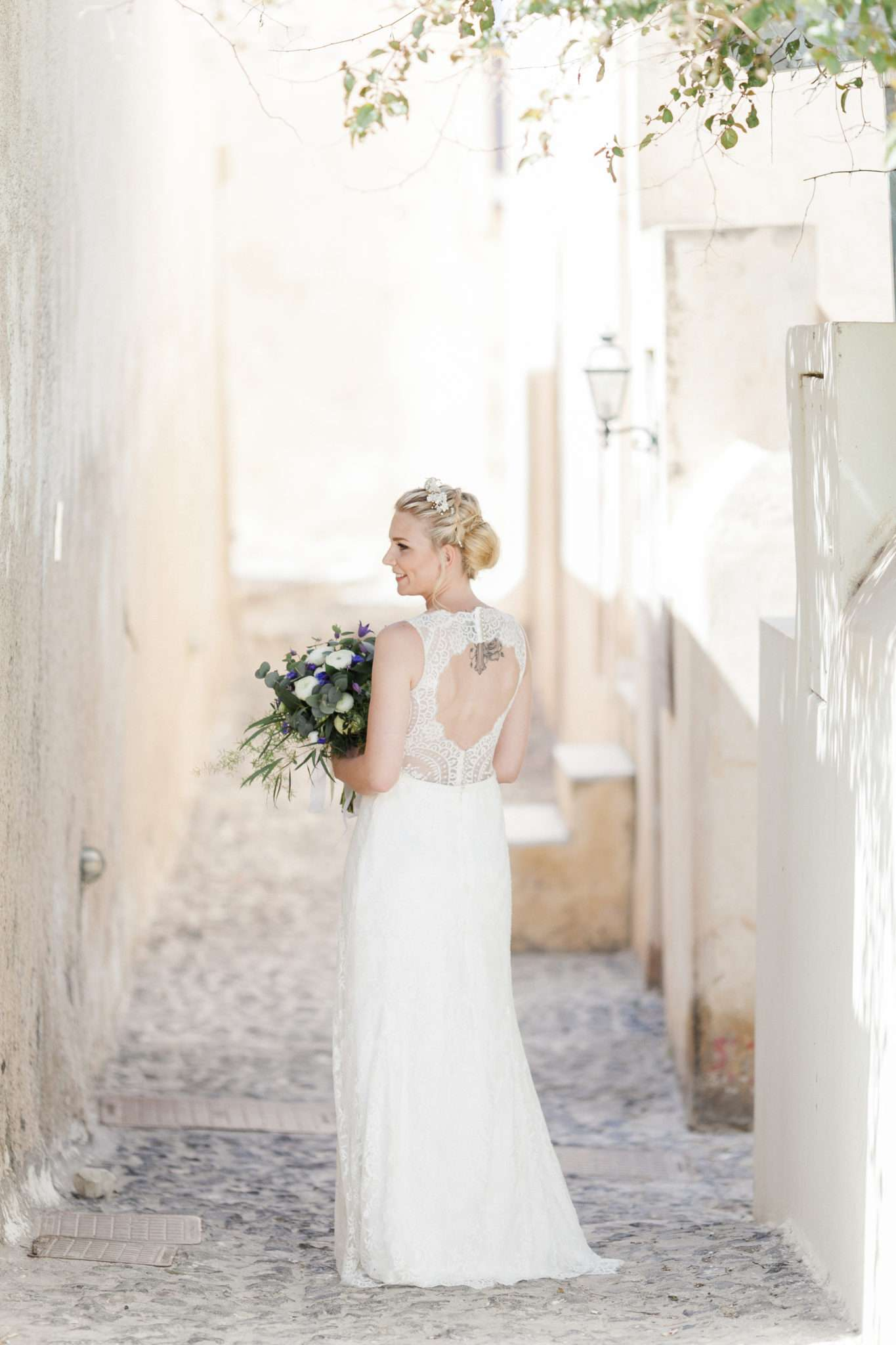 bride with a lacey long white wedding dress