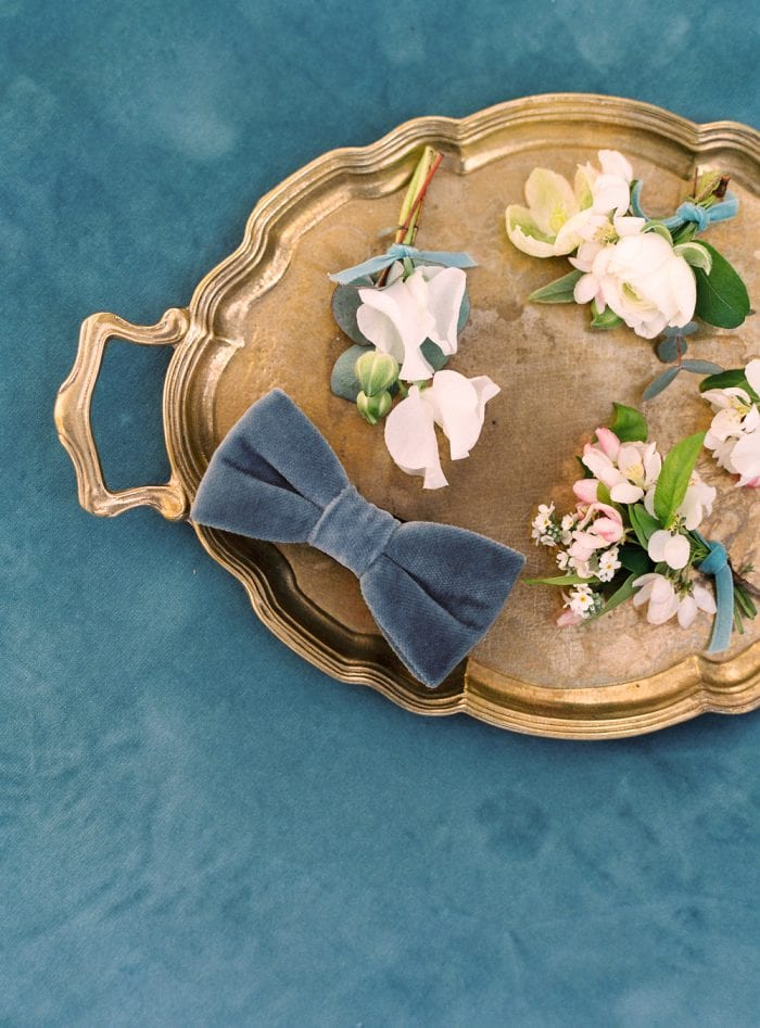 boutonneries velvet bow tie velvet themed wedding dusty blue color palette getting married in germany wedding castle in germany