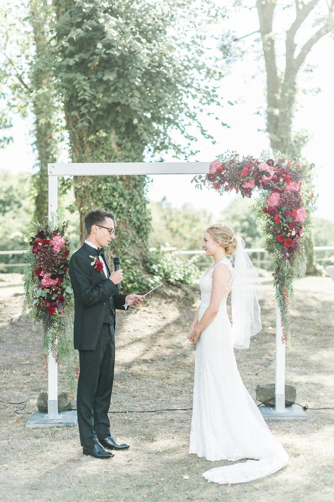 wedding ceremony, wedding vows, flower arch