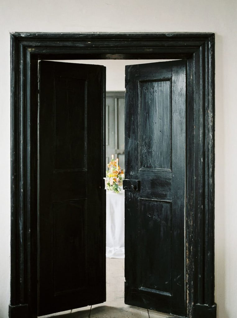 wedding destination with a beautiful black door