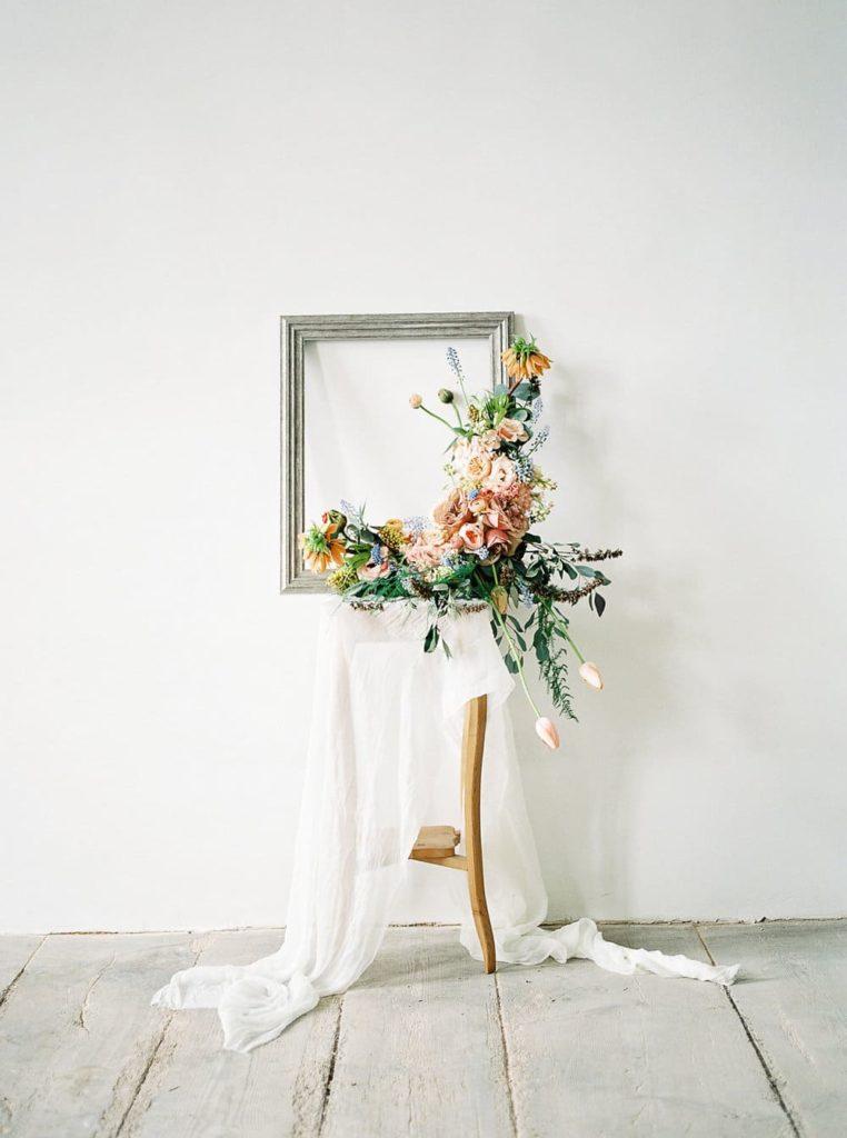 wedding flower arrangement with spiced colour flowers