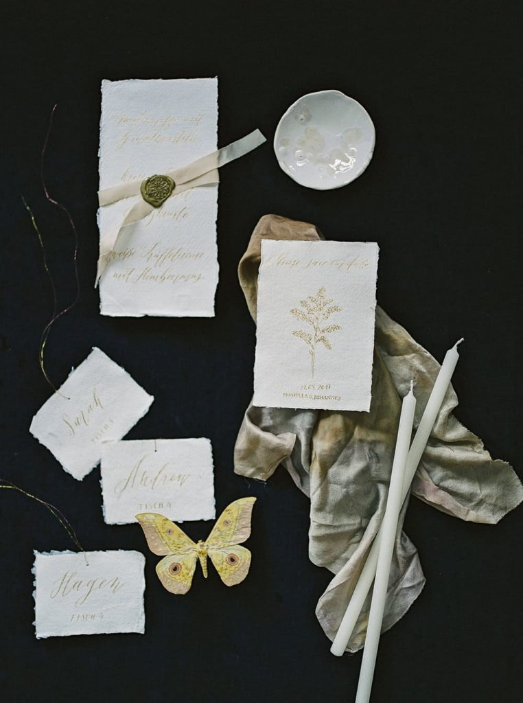 white and gold table card and invitation