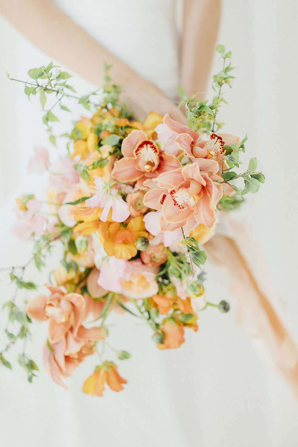 bridal bouquet, orchids and ranunculus, wedding flowers, wedding florals, bouquet in orange and yellow