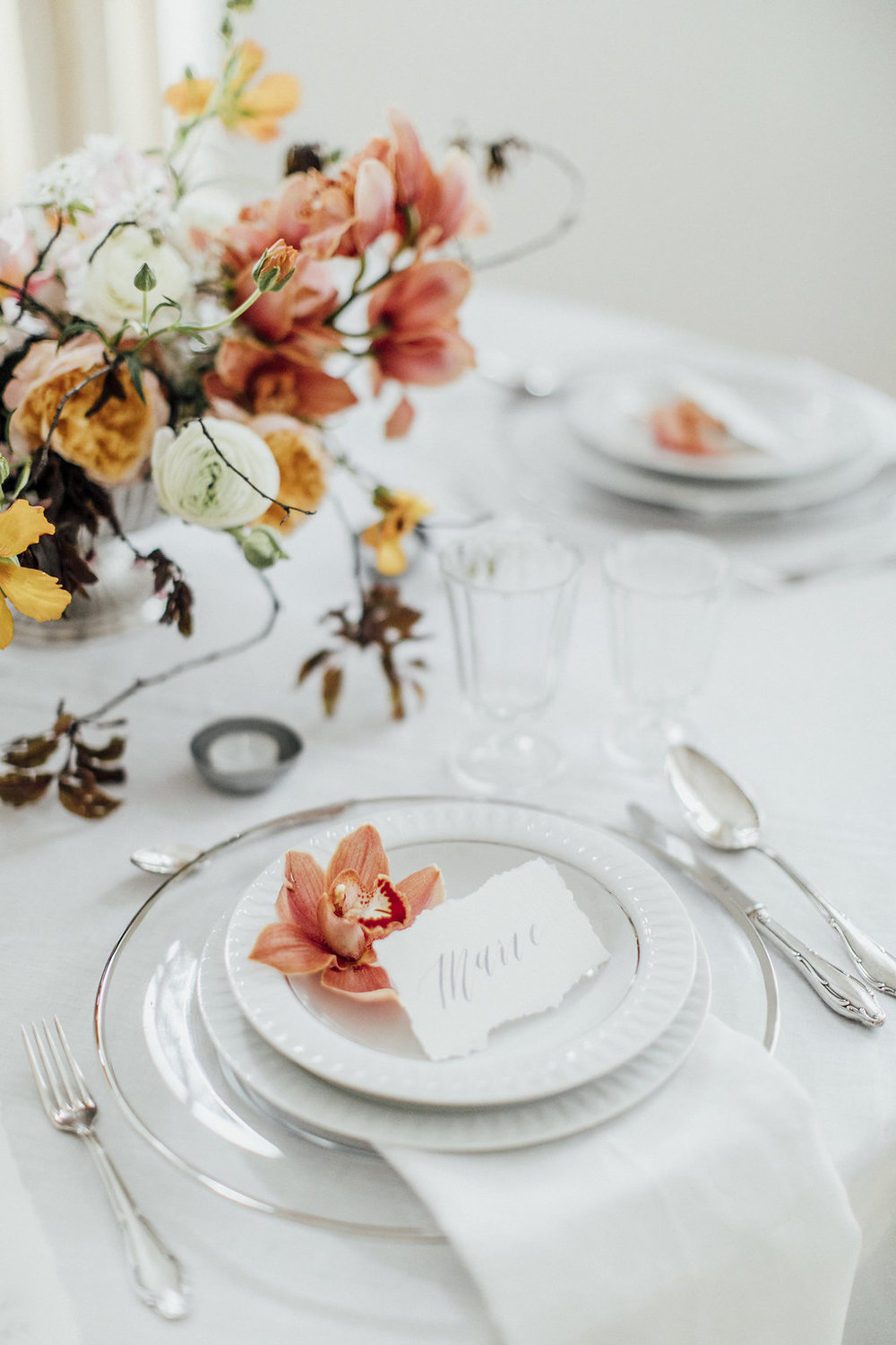 wedding table decoration, wedding reception, table scape in white orange and silver